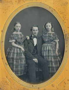 The apples of papà's eye...1850s. Both girl's have a ring on their forefinger.