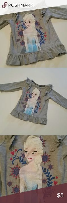 Disney Frozen Elsa Top in GUC Super cute Elsa long sleeve Top well loved but perfect for play clothes, preschool etc. Price reflects used condition (Consider bundling to get more value out of the cost of Shipping and feel free to make offers on bundles)  Smokefree Petfree Clean Home? Thank you for visiting my closet!! Disney  Shirts & Tops Tees - Long Sleeve