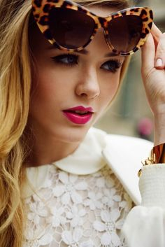 pink lipstick, white lace, cat eye sunglasses
