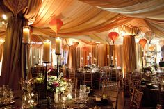 A Moroccan setting with amber ombre fabric treatment and suspended silk lanterns. Floral & Decor by: KehoeDesigns.com, Photography by: Rena Brenner, Planning by: Jennifer Anderson & Associates, Venue: Room 1520