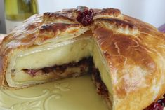 Baked Brie Stuffed with Fennel, Dried Cranberries and Port.  Turn a simple wheel of brie cheese into a show stopping appetizer whose good looks are a perfect prelude to a romantic dinner, with its wonderful balance of rich, sweet, warm and tangy flavors. Anolon.com