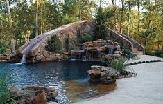 Freeform pool with beach entry, waterfall, and giant custom water slide. Pool by Custom Pool Concepts, The Woodlands, TX  http://www.luxurypools.com/swimmingpoolbuilder/Custom-Pool-Concepts?fid=161