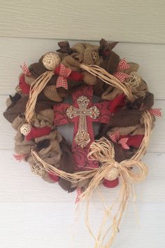 Handmade burlap cross wreath. Items used purchased at Hobby Lobby.