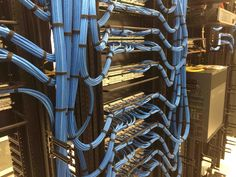 412 Ethernet Drops neatly bundled into patch panels. Cisco 4507E router with excellent cable management!