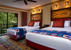 Disney's Wilderness Lodge Queen beds, end table, sconces, ceiling fan and patio view of courtyard Walt Disney World Vacations, Disney World Resorts, Top Hotels, Hotels Near, Yosemite Lodging, Disney Fast Pass, Romantic Weekend Getaways, Park Lodge, Disney Home