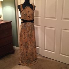 Dress Gold yellow, cream and black  with black material detail and cut out design on top. Never wore. I have to many clothes.  Lovecrazy Dresses Maxi