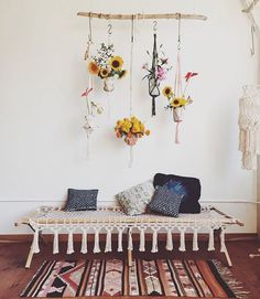 this is a little more funky but you could have plants hanging from your ceiling. maybe 3 or 5 different types of plants in gold pots.