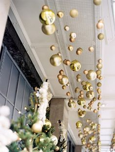 gold and silver balls from the ceiling Claridges, London Winter Art Deco Ballroom Wedding Read more - http://www.stylemepretty.com/2013/12/23/claridges-london-winter-art-deco-ballroom-wedding/