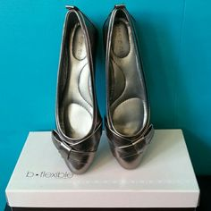 "Bandolino ""Valiant"" Flat- Pewter Super comfy :) Cute little bow detail in front makes it a bit dressy than your casual flats. Comfort and style together :) Man-made upper and man-made sole. Wedge heel measures about .75"". Bandolino Shoes Flats & Loafers"