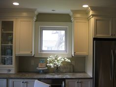 Awesome way to disguise bulkhead in kitchen.  I'm going to do this!