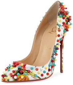 """Christian Louboutin floral-print embossed leather pump with multicolor spikes. 4.8"""" covered stiletto heel. Pointed toe frames low-cut vamp. Creamy leather lining with padded insole. Signature red leather outsole. """"Follies"""" is made in Italy."""