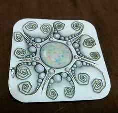 Zentangle with an opal gem centerpiece. By LuAnn Roosa 7/16. Zentangle, ZIA, zendala, gemdala, microns, colored pencil, art, artwork, drawing, gem, opal.