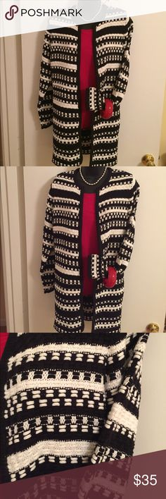 Chicos Black and White Cotton Open Cardigan-NWOT Excellent Condition-Never Worn. 65% Cotton, 25% Acrylic, 11% Nylon.  Thick Cotton Feel Yet Lightweight. Black and White Colors. Truly Stunning Sweater with Red Jeans or Cords. Size 1, Medium, Misses 8-10. Chico's Sweaters Cardigans
