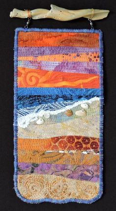 Everyday at the Beach is Different #6.  A small fiber art quilt by Eileen Williams.