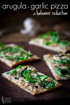 Thin-crust arugula pizza with garlic and balsamic reduction. Great appetizer or dinner recipe.