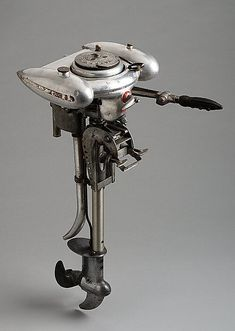 """John Morgan for Sears, Roebuck and Co., """"Waterwitch"""" Outboard Motor, 1936. Steel, aluminum, and rubber. Courtesy Metropolitan Museum of Art"""