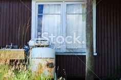 A rusty old washing machine against a corrugated iron bach wall. Old Washing Machine, Image Now, Kiwi, Abandoned, Remote, Royalty Free Stock Photos, Building, Places, Wall
