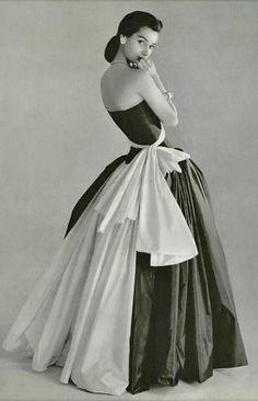 From Harpers 1956. Love the dress and the simplicity of the hair & make up.