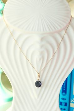The perfect little gold necklace with an eggplant pendant to complete your favorite outfits! Love!