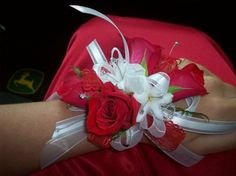 A wristlet of red roses, white hyacinth, sparkly rhinestones and sheer and satin white ribbons. By Jen-Mor Florist, Dover, DE. www.jenmor.com