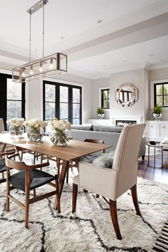 Using alternative end chairs in your dining area looks great. The lighting fixture in line with the flower decor.