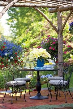 Wooden canopy to shade the flowers and outdoor furniture really blends your backyard in with nature.