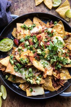 Chipotle Braised Chicken Nachos recipe: Slow cooked chicken, braised in cider be… Slow Cooked Chicken, Braised Chicken, How To Cook Chicken, Shredded Chicken, Beef Nachos, Good Food, Yummy Food, Tasty, Cooking Recipes