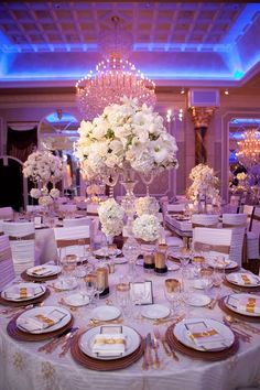 Gold will be a big trend in 2016 - here it's the perfect accent for an elegant black and white table ~ https://www.insideweddings.com/weddings/purple-white-gold-new-jersey-celebration/339/