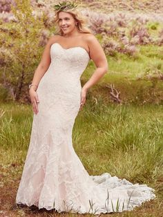 Maggie Sottero - KIRSTIE, Elegant lace appliqués drift atop tulle to create this breathtaking bohemian sheath plus size wedding dress, with a timeless, romantic sweetheart neckline. Finished with covered buttons over zipper and inner corset closure. #PlusSizeWeddingThings