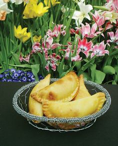 Half-moon shaped baked Easter pastries, filled with sweetened ricotta