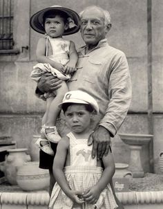Pablo Picasso with his children Claude and Paloma, 1951