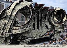 "Look closely - the word ""Rhino"" is cleverly embedded in this 3-story rhinoceros parade float. Bloemencorso Zundert, Netherlands (2009)"