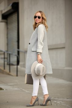 Fall / Winter - street chic style - work outfit - office wear - business casual - grey long vest + cream sweater + white skinnies + grey stilettos + light grey wool fedora + neutral toned tote + aviators