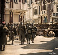 """May 24:  Fionn Whitehead joins French soldiers on a street barricade at Belle Rade in the city of Dunkerque.  """"Nouvelles photos du tournage prises par Vincent Villemaire. @jordanmanie/twitter"""