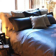 INTERNATIONAL AND DOPPIO AJOUR  Frette's timeless classic Doppio Ajour bed linen is enhanced by International's bold interlocking hexagon pattern in lustrous mixed silk jacquard.
