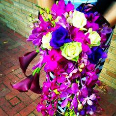 #CascadeBouquet #BridalBouquet featuring #PurpleCallaLilies #PurpleDendro #Orchids #GreenRoses in gorgeous #PurpleWedding #WeddingFlower #Bouquet.  Created by #LexingtonFloral in Shoreview, MN