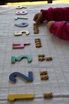 Use wooden puzzle numbers for counting activities.