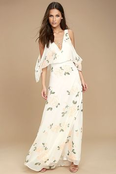 The Very Thought of You White Floral Print Maxi Dress has been on our mind! Rose print woven poly maxi dress with off-the shoulder sleeves.