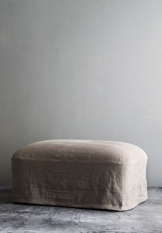 OLIVER GUSTAV  POUF WITH LINEN UPHOLSTERY  W 75 X D 55 X H 35 CM  MADE TO ORDER  AVAILABLE IN OUR COPENHAGEN  STUDIO AND NEW YORK CITY STUDIO