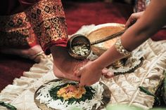 Washing the man's foot, symbolizing wife's dedication towards her husband
