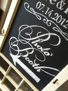 Photo Booth: hand-lettered chalkboard signage in an antique window frame