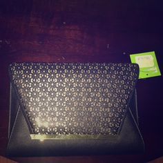 NWT's Black & gold spacious envelope clutch. NWT's Super cute black & gold spacious envelope clutch with gold chain strap. The bag can be carried with our without the chain. Kelly & Katie Bags Clutches & Wristlets