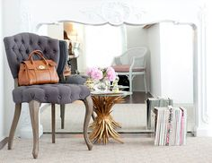 I kind of love this. I know this is a fireplace but could a mirror maybe work under a foyer table?