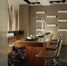 wood design - cabinets and back countertop - right corner. taupe chairs; neutrals. soothing; rustic chic could go with it
