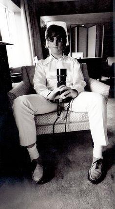 John Lennon with a camera