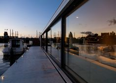 Floating home by +31 Architects moored on Amsterdam river