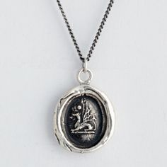 Dragons are magical creatures that have the power to see all things clearly. They are emblems of good fortune and protection. PYRRHA Pyrrha signature talismans are handcrafted using authentic wax impressions and imagery from the Victorian Era. Each design has symbolic meaning culled from heraldry. Handcrafted in Vancouver, Canada.