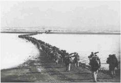 Chinese Troops crossing into Korea.  Korean War