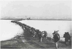 Chinese Troops crossing into Korea.  Korean War