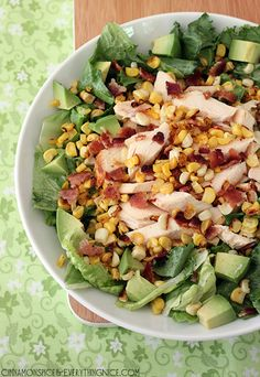 Chicken, Bacon and Corn Salad w/ Honey Lime Vinaigrette   Tender rotisserie chicken comes together with bacon, avocado, grilled corn and romaine lettuce in a honey lime vinaigrette to make this bright and tasty salad